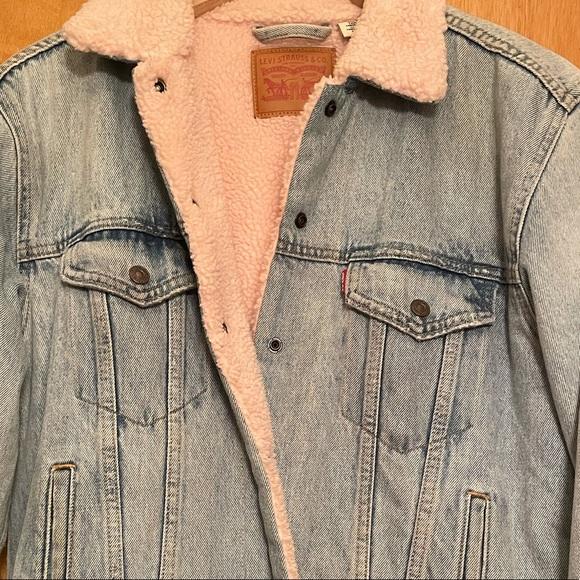 A vintage pink fleece Levi's jean jacket